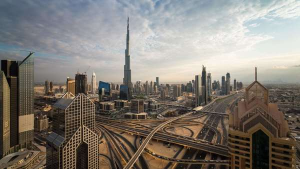 The Burj Khalifa Dubai, elevated view across Sheikh Zayed Road and Financial Centre Road Interchange, Downtown Dubai, Dubai, UAE - timelapse Royalty-free stock video