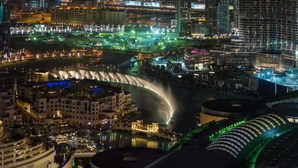 United Arab Emirates, Dubai, the Burj Khalifa, elevated view looking over the Dubai Mall - timelapse Royalty-free stock video