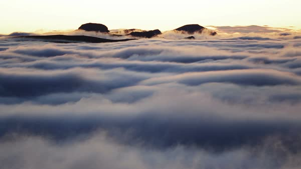 Clouds below a temperature inversion. Rights-managed stock video