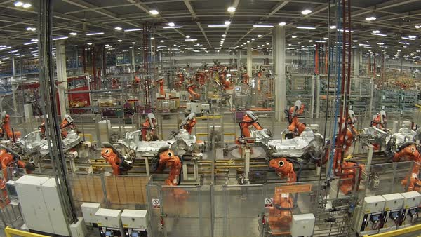 Timelapse footage of robot arms on production lines at a car manufacturing factory. Royalty-free stock video