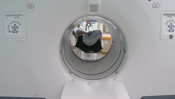 Positron emission tomography (PET) scanning. Footage of a hospital PET scanner being used to image a patient. This is a Discovery PET scanner from GE Healthcare. Photographed in 2016 at St Thomas' Hospital, London, UK. Rights-managed stock video