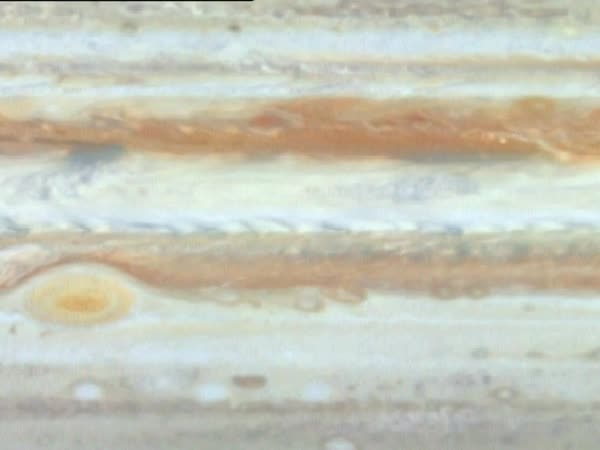 Cloud bands on Jupiter. Footage from a space probe of cloud bands swirling in the atmosphere of Jupiter, the largest planet in the solar system. Rights-managed stock video
