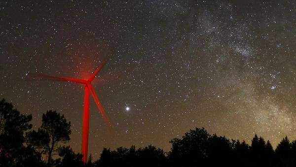 Timelapse of a wind turbine with the Milky Way. Rights-managed stock video