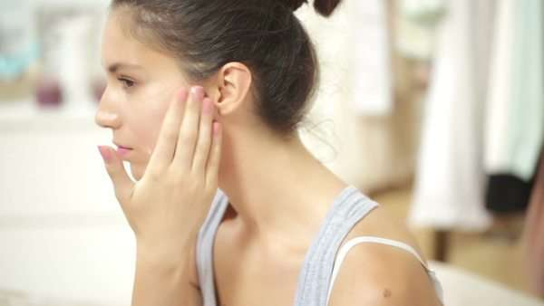 Young woman applying face cream. Royalty-free stock video