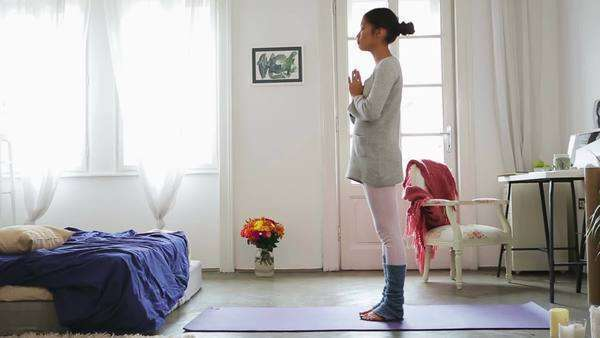 Young Asian woman doing yoga at home. Royalty-free stock video
