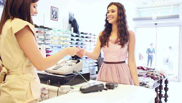 Woman paying for the clothes she has bought at a boutique. Royalty-free stock video