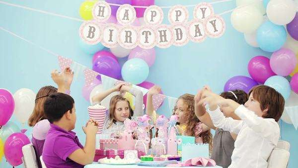 Group of children singing a song on a birthday party. Royalty-free stock video