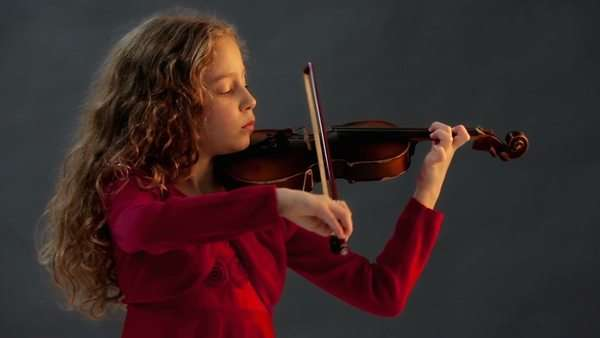 Cute girl playing the violin. Royalty-free stock video