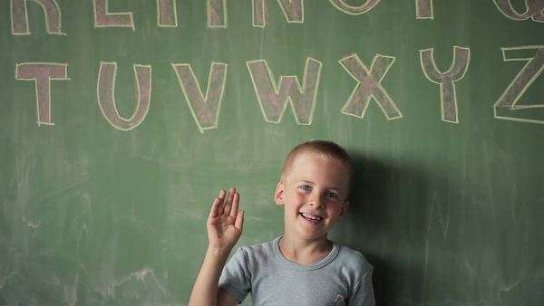 Portrait of a Happy Caucasian Schoolboy Waving His Hand Royalty-free stock video