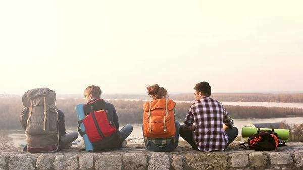 Group of Hikers Sitting on a Wall Royalty-free stock video