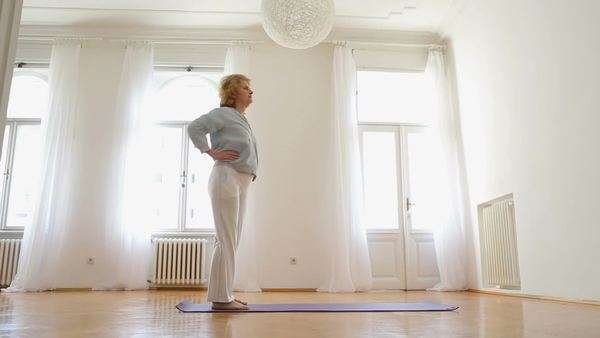 Senior Caucasian woman doing exercise at home. Royalty-free stock video