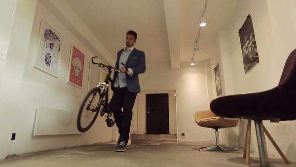 Modern Caucasian businessmen arriving at work with their bicycles. Royalty-free stock video