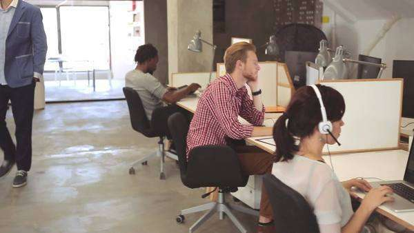Multiethnic group of people working together at an open office. Royalty-free stock video