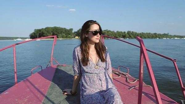 Beautiful woman with sunglasses enjoying a boat ride. Royalty-free stock video