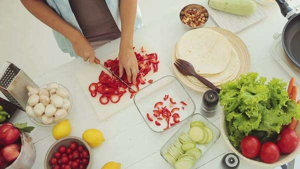Overhead view of a woman chopping a red pepper. Royalty-free stock video