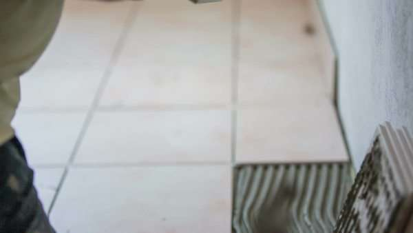 Floor Construction With Tiles Top View Professional Worker