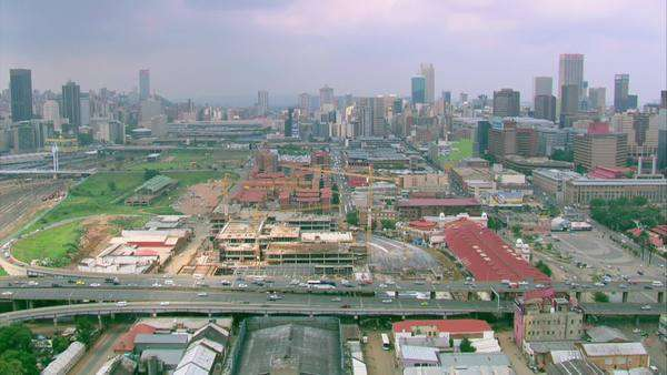 Aerial shot of the M1 highway going into Johannesburg city centre Rights-managed stock video