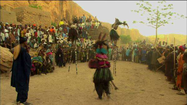 Long shot of Dogon stilt dancers at the Dama dancing ceremonies Rights-managed stock video