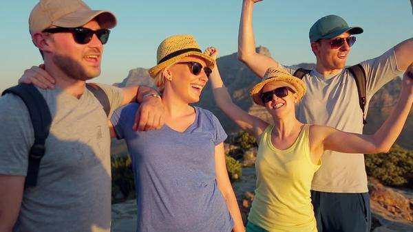 Handheld of two happy couples on top of Lion's Head Rights-managed stock video