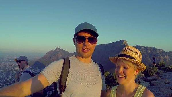 Handheld shot of a couple on top of Lion's Head taking a selfie Rights-managed stock video