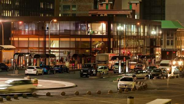 Static timelapse at night of a bus station and parking area in Ghandi Square in the city centre of Johannesburg, South Africa Royalty-free stock video