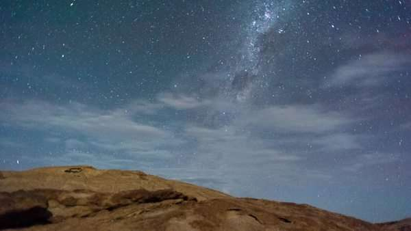 Linear timelapse at night with a moonlit landscape scene in the Namib Desert, granite rocky outcrops at Bloedkoppe in the Naukluft Park Royalty-free stock video