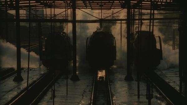 Locked off shot of silhouetted men moving about on railway tracks Rights-managed stock video