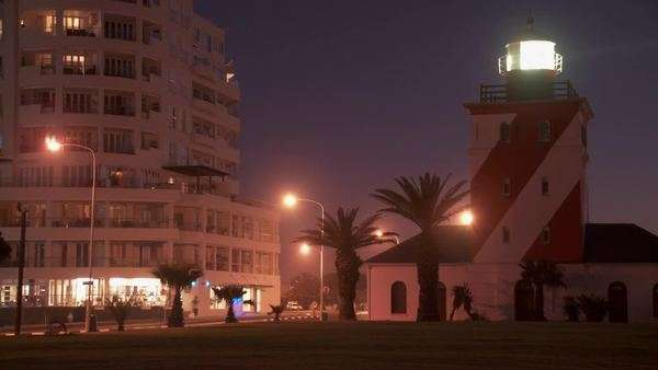 Time lapsed long shot of apartment building and the Green Point Lighthouse at night Rights-managed stock video
