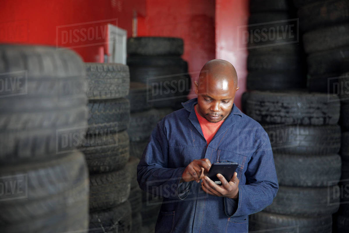 African man checking his smart phone on appointments for the day Royalty-free stock photo
