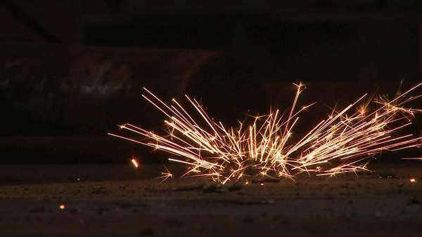 Extreme close up of sparks caused by grinder Rights-managed stock video