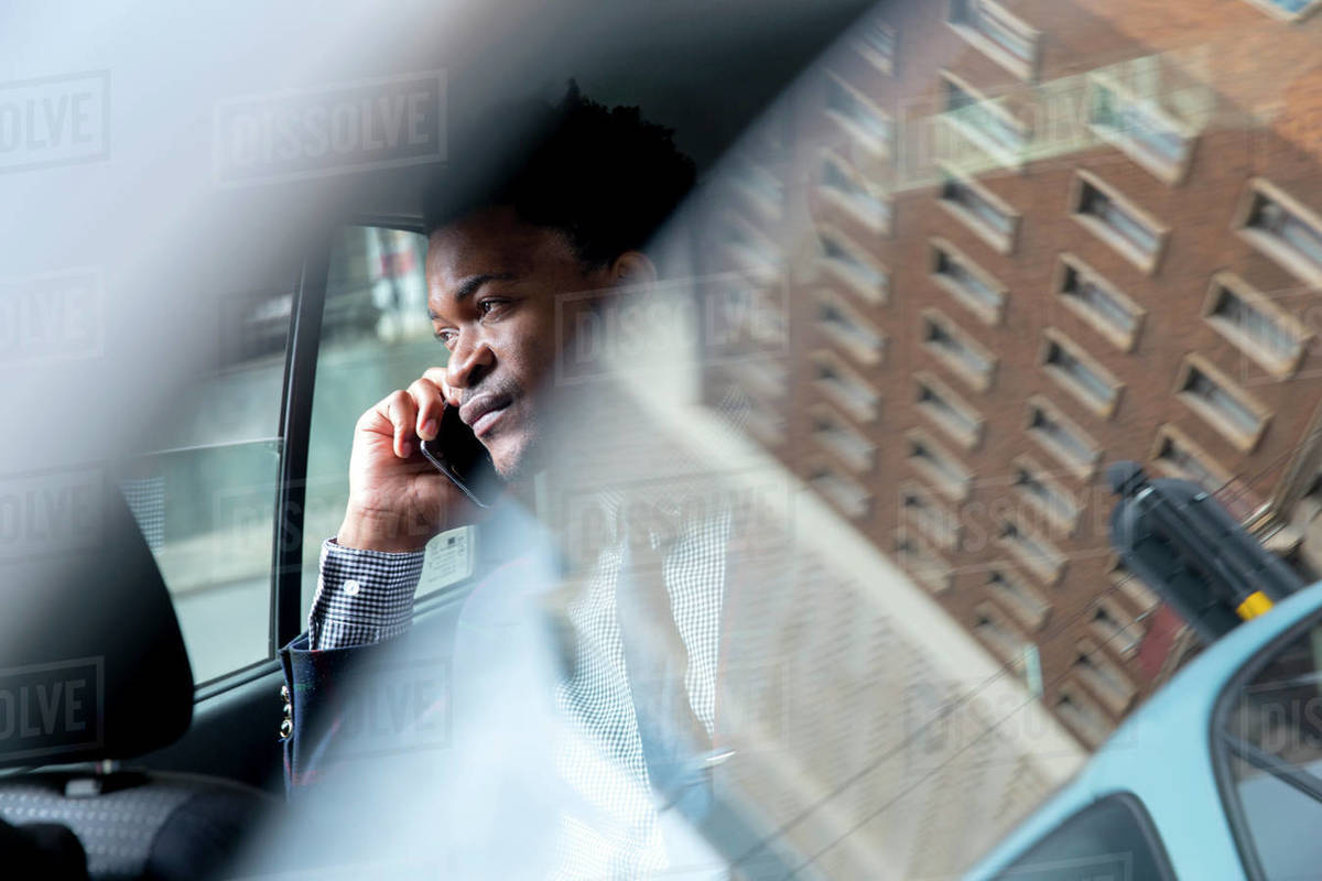 Business man seen through car window Royalty-free stock photo