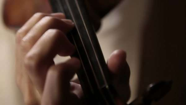 Close up pan shot of a violin player Royalty-free stock video