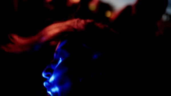 Slow motion of a face of a woman under colorful lights Royalty-free stock video