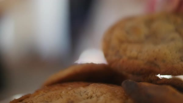 Static shot of a person taking a cookie from a pile Royalty-free stock video