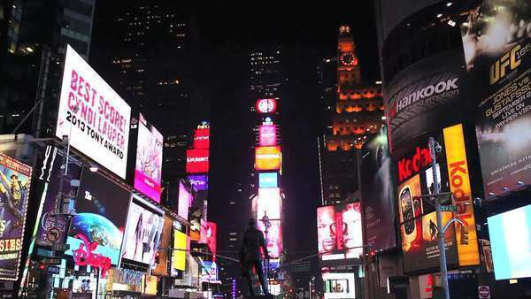 Tilt down shot of Times Square lit up and crowded at night Royalty-free stock video