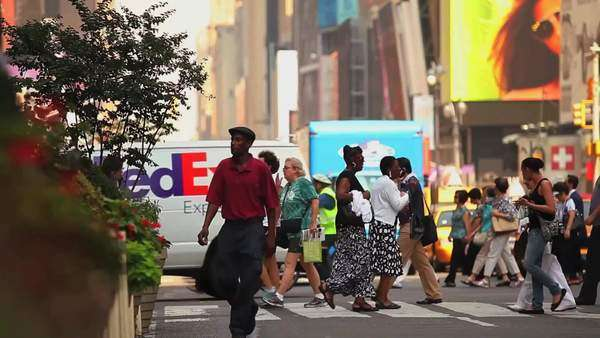 Pedestrians pass on a busy street in New York City Royalty-free stock video