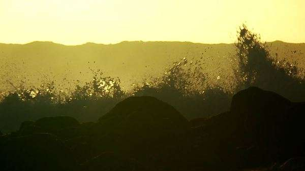 Large waves as they crest and break in slow motion at sunset. Royalty-free stock video