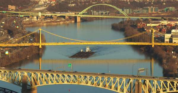 Barges travel under the bridges of Pittsburgh, PA. Royalty-free stock video