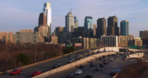 Traffic on a freeway heads into Philadelphia, PA at dusk. Royalty-free stock video