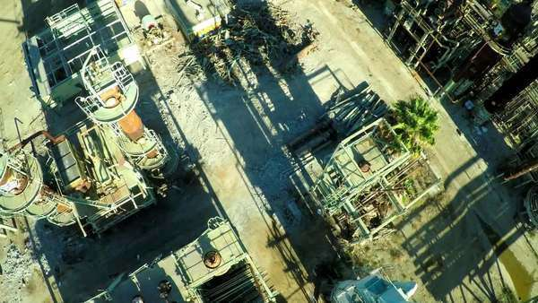 Aerial looking down a smokestack over an abandoned oil refinery. Royalty-free stock video