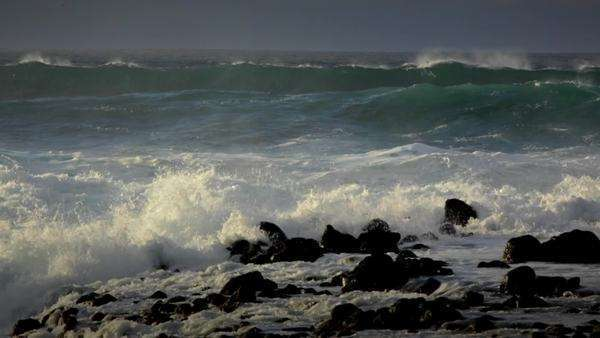 Big waves roll into a beach following a big storm in slow motion. Royalty-free stock video