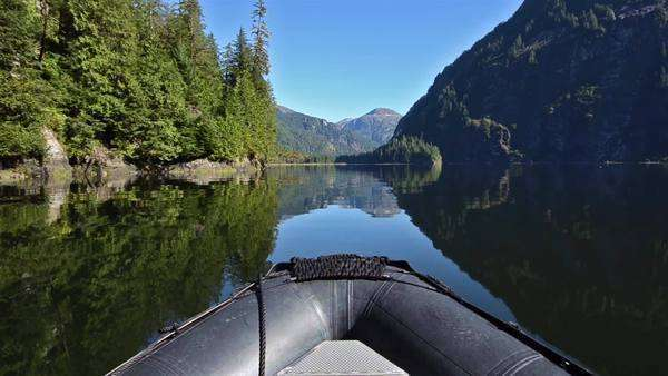 POV boat ride cruising through glassy waters in Fords Terror in Tracy Arm-Fords Terror Wilderness Area, Southeast Alaska. Royalty-free stock video
