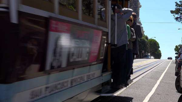 A cable car goes up a hill in San Francisco. Royalty-free stock video