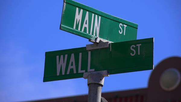The corner of Main Street and Wall Street is a real intersection in America. Royalty-free stock video