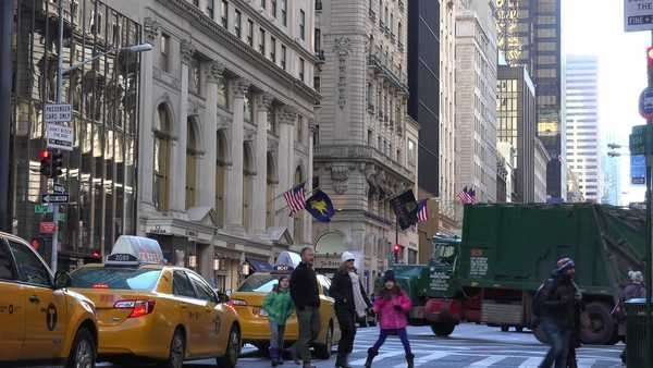 A nice shot along 5th avenue in New York City with pedestrians and traffic. Royalty-free stock video