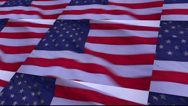 an animated u s flag flies in the wind in stop motion stock