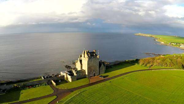 An aerial of a beautiful Scottish or English castle estate in sunset light. Royalty-free stock video