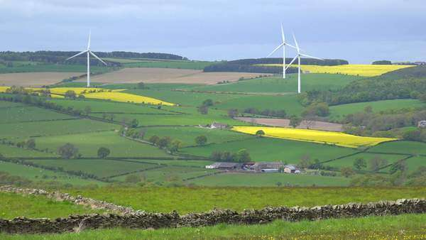 A wind farm in England generates power amongst farm fields. Royalty-free stock video