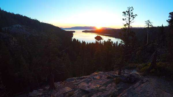 A beautiful aerial shot at dawn over Emerald Bay Lake Tahoe. Royalty-free stock video