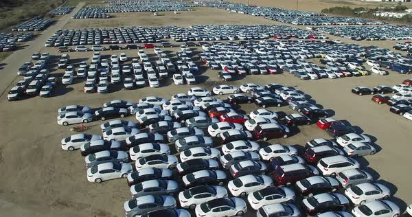 Aerial perspective of new import cars sitting in a lot awaiting distribution and sale. Royalty-free stock video